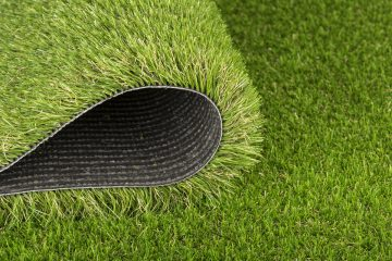 usar cesped artificial como alfombra en tu hogar